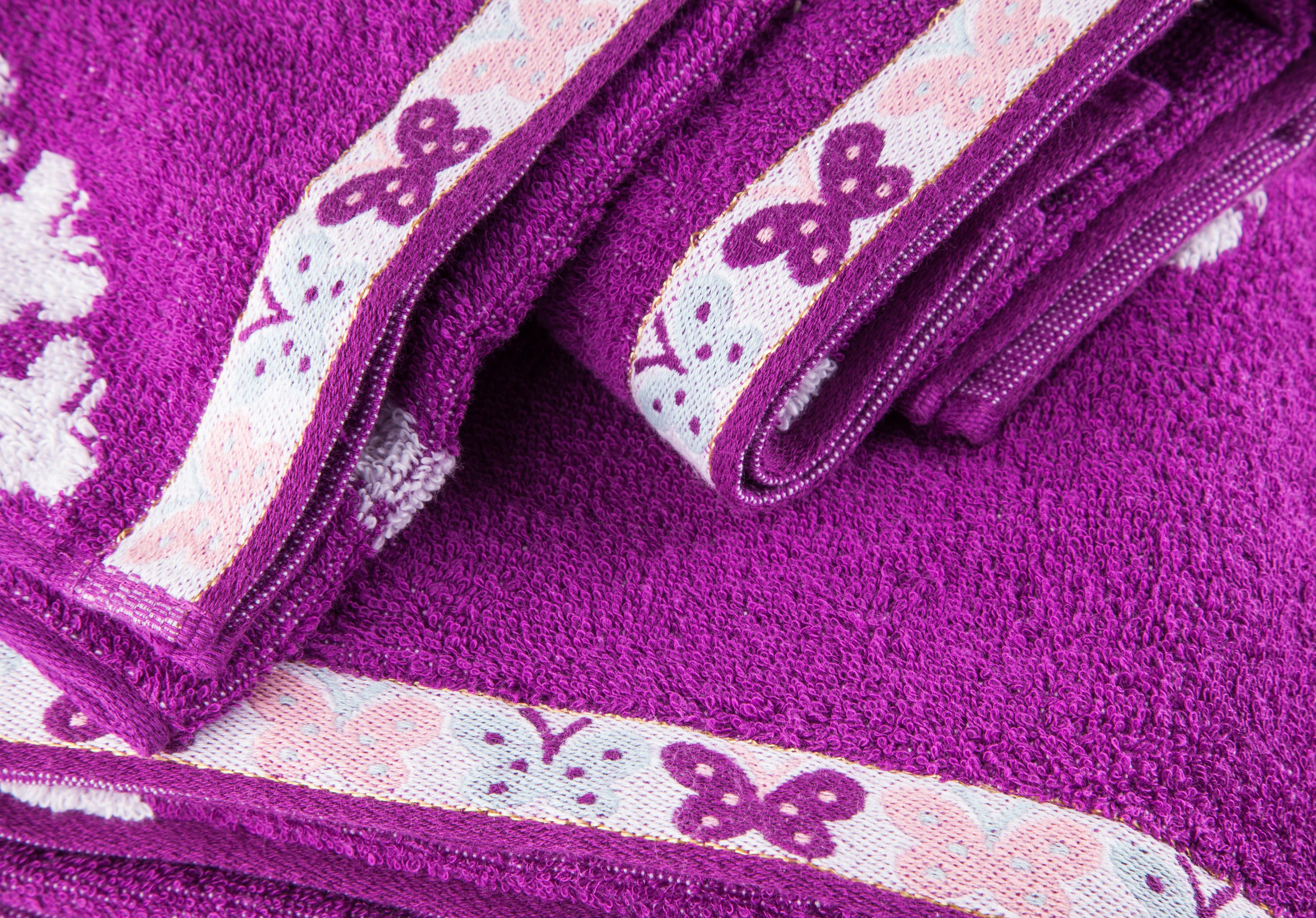 Woven border towel.