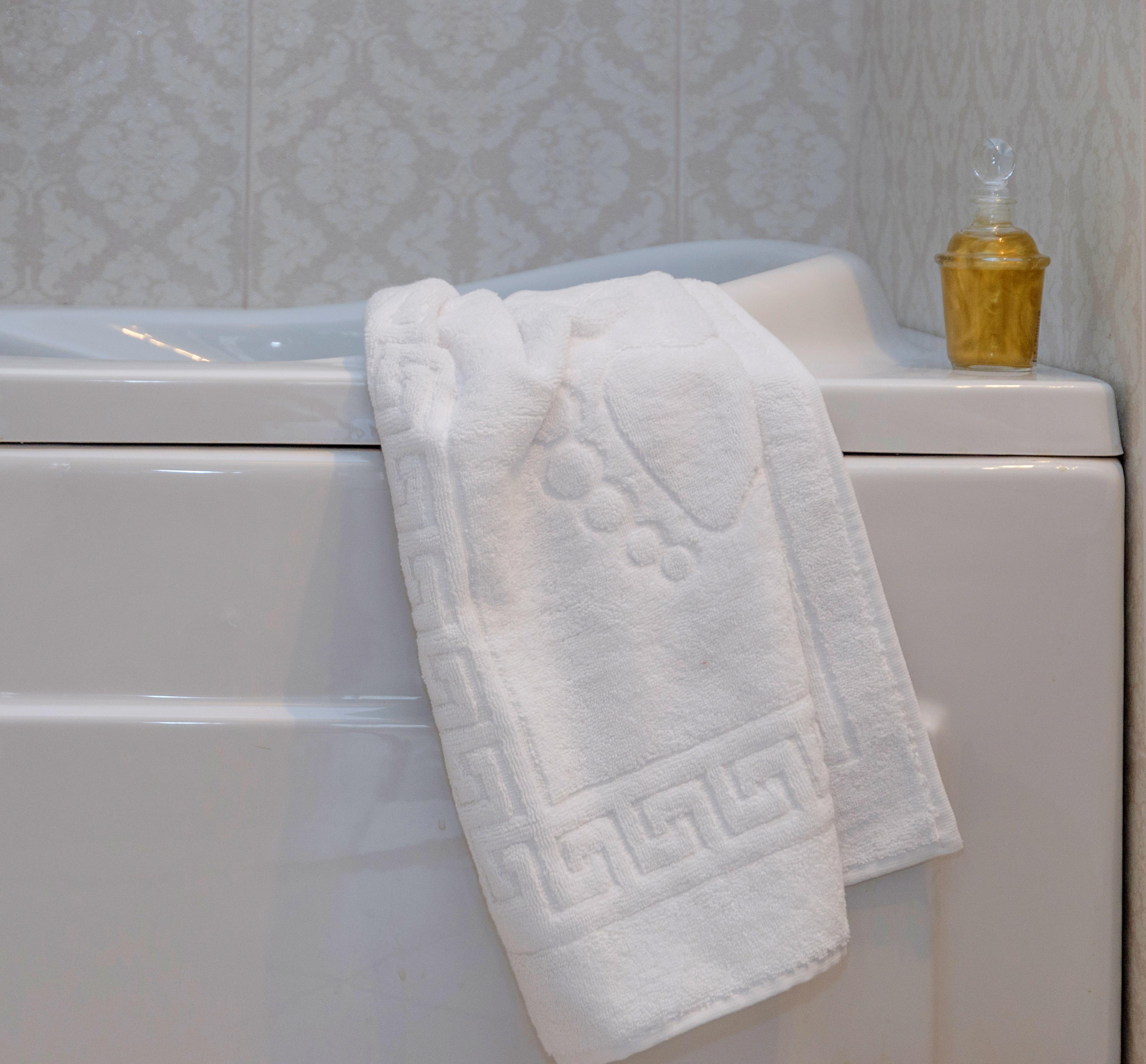 Relief woven bath mat.