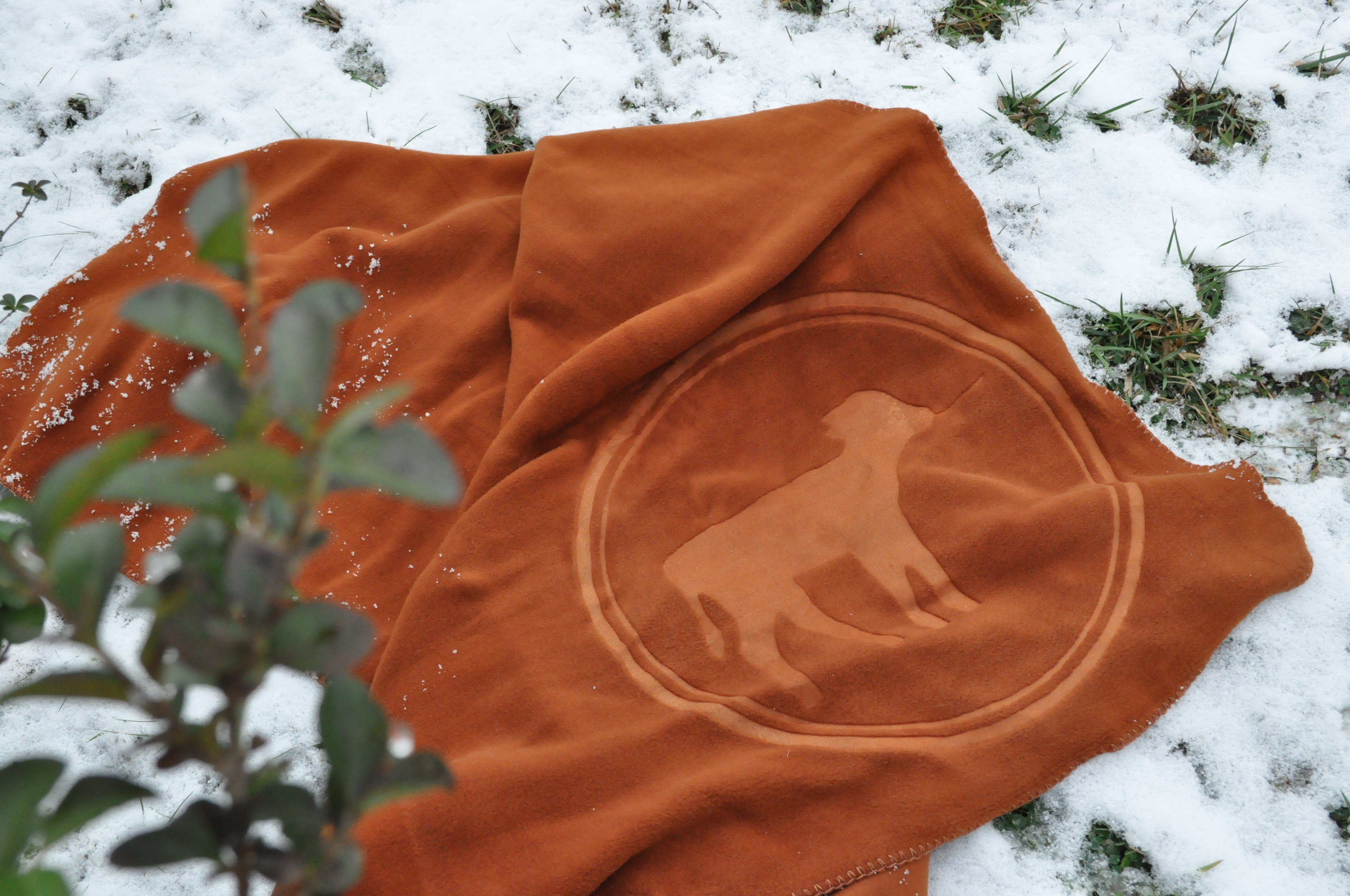 Embossed polar fleece blanket.