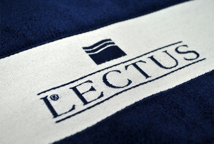 Promotional woven border towel