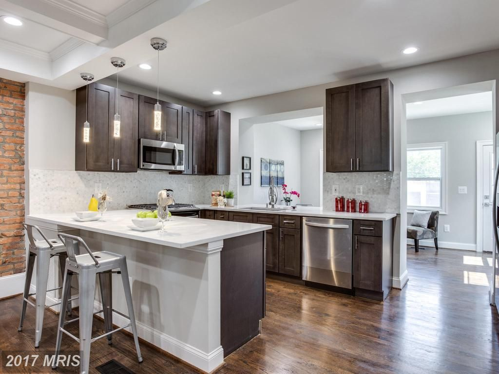 high end kitchen with bar