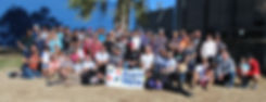big group shot at park with banner.jpg