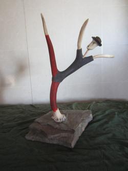 High kick (antler, stone base)