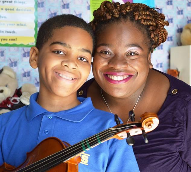 Calida Jones of Bravo Waterbury! with student violinist