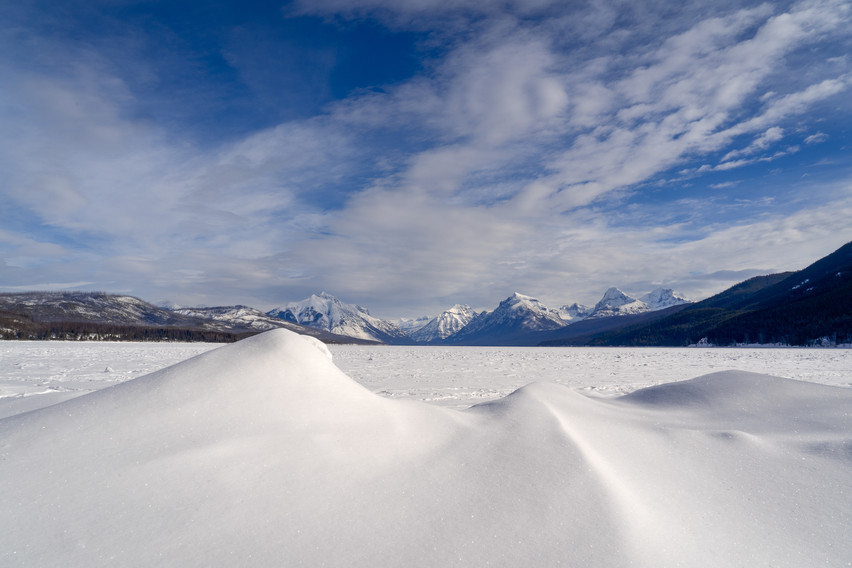 The winter wind whips over Macdonald Lake to form big mounds of snow that resemble ice cream.