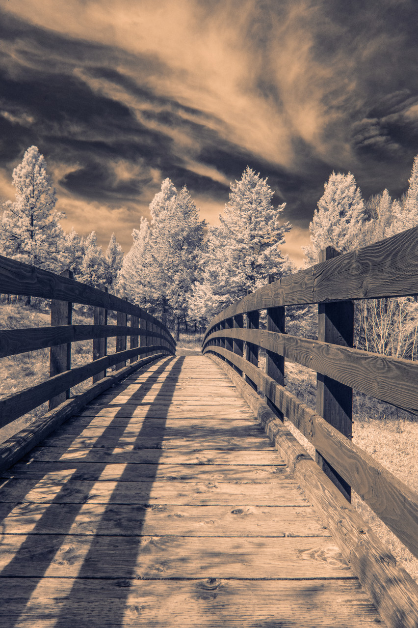 An infrared shot of the bridge leading down to the beach at Rexford