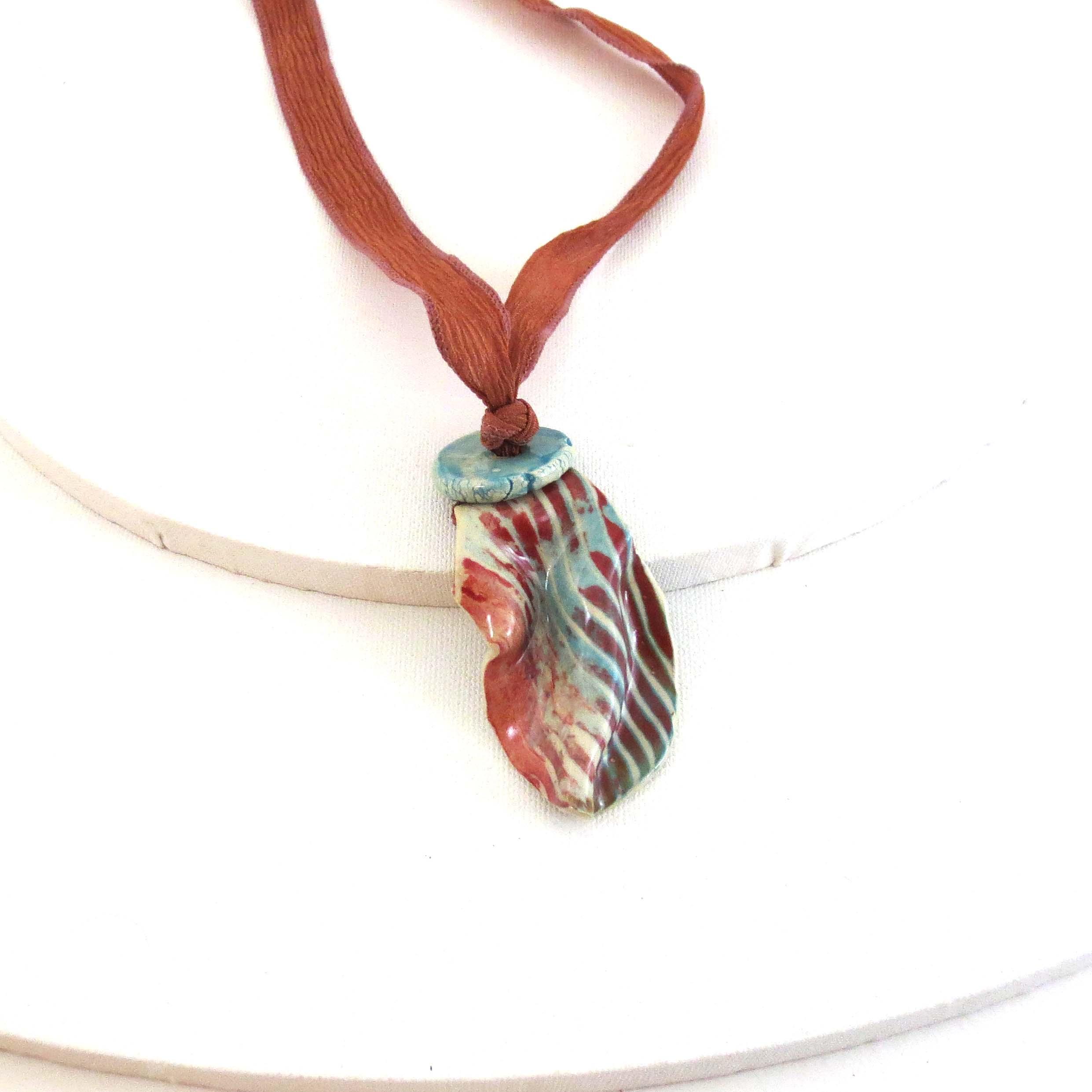 Turquoise & rust ceramic pendant