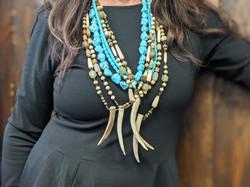 Paula Cornell jewelry on bust