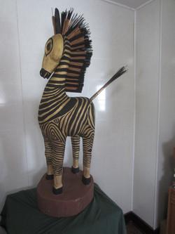 Zebra in body suit (wood, reeds)