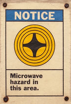 photo of a posted microwave hazard sign.