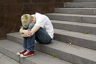 upset young man sitting on stairs put hi