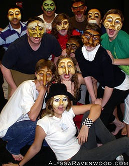 A group of high school theatre students wearing Commedia'Dell'Arte masks.