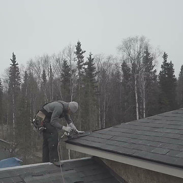 Owner, George Lochner, works on a roof