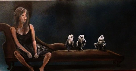 Girl sitting on sofa with 3 owls on sofa also