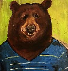 brown bear in blue jumper
