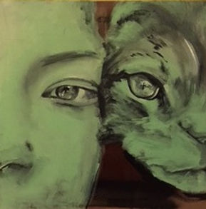 Girl with face against her cats face