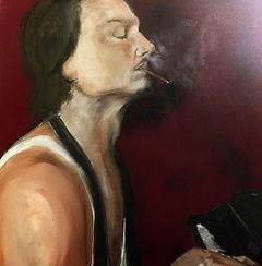 Man smoking while playing the piano