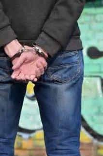 arrested 3rd.jpg