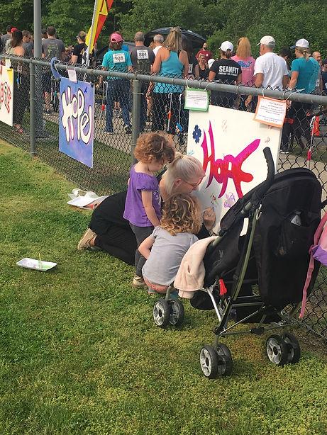 CHRISTINA AND KIDS AT HOPE WALL END ADDI