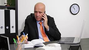 videoblocks-businessman-use-mobile-phone