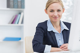 confident-business-woman-with-computer-a