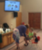 Pastor Lesley with children at Kids' Time during worship