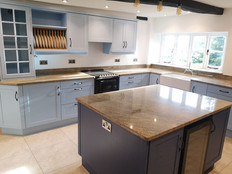 Beautiful Contemporary light blue kitchen with a blue island unit
