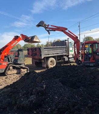 Concrete Blacktop Soil Removal | Western NY | Grasshopperz Property Maintenance