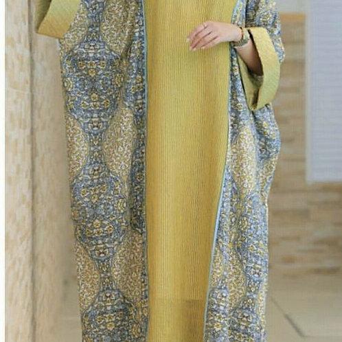 Designer Yellow Kaftan With Blue Emerald On It