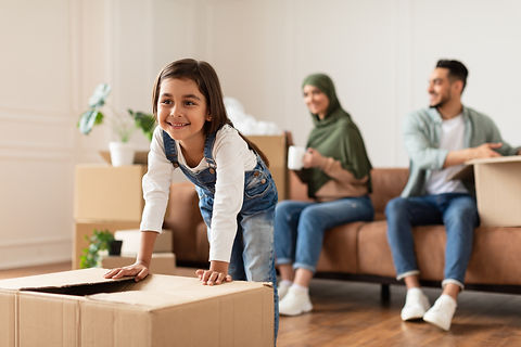 House Move And Relocation Concept. Portrait Of Cheerful Muslim Family Housing, Selective F