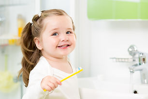 Child learning to brush teeth