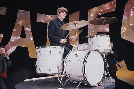 Ringo Starr with Ludwig white marine pearl rental drum kit. February 8, 1964. Camera blocking for Ed Sullivan Show. Historian Lecturer Gary Astridge