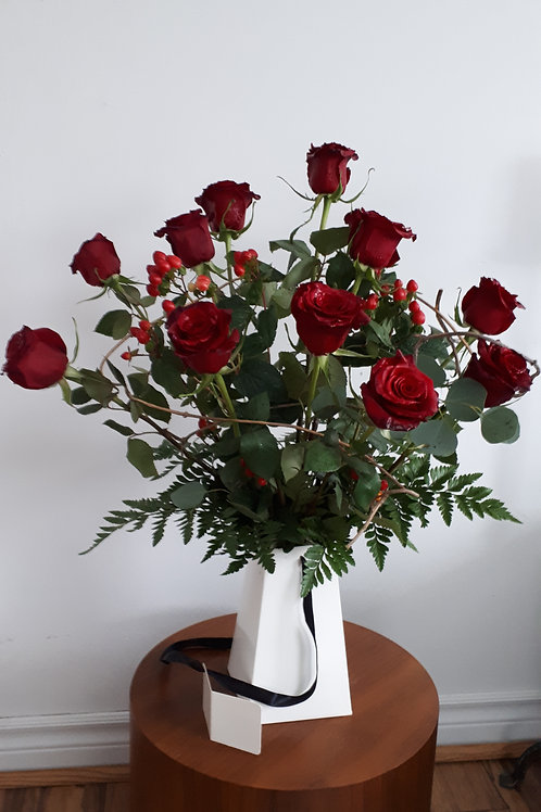 High quality long stem roses arranged in a modern white box.