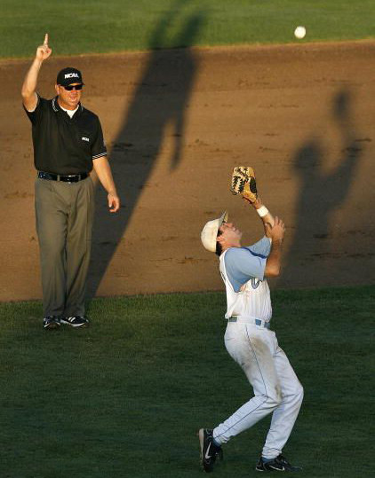 Umpire signals Infield Fly Rule