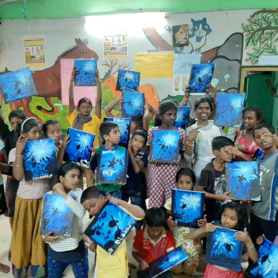 Children presenting their canvases