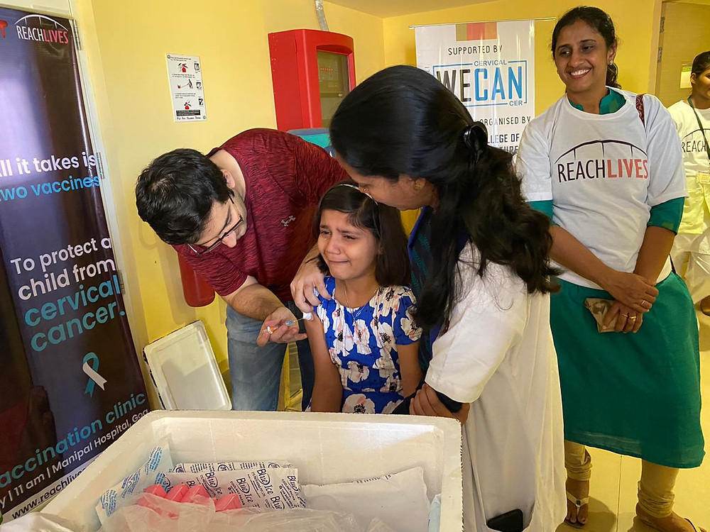 Doctor vaccinating a child