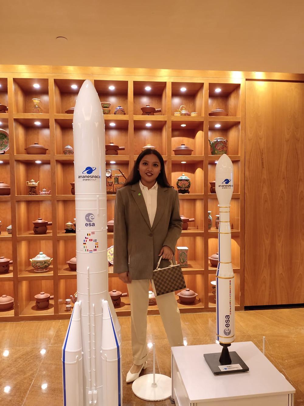 Kareema khan next to model aircraft