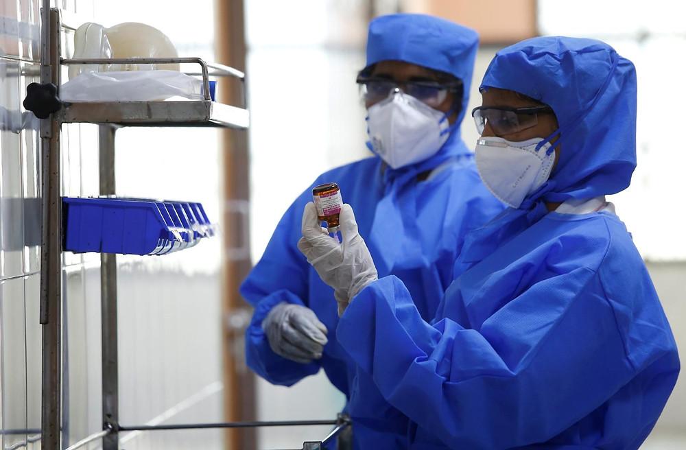 Lab workers testing blood