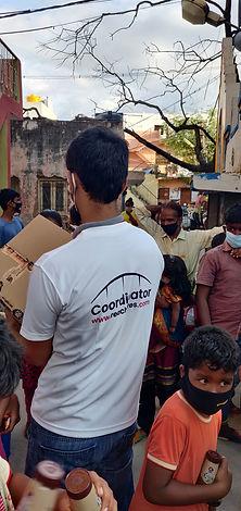 Reach Lives volunteer distributing supplies
