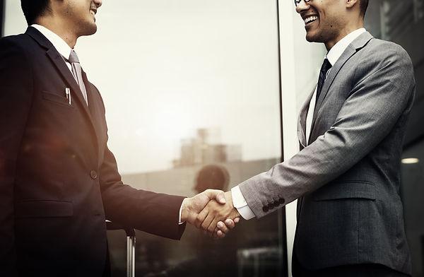 corporate-businessmen-shaking-hands.jpg