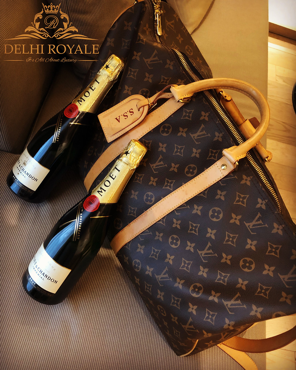 Louis Vuitton Keepall 55 And Moet Champagne