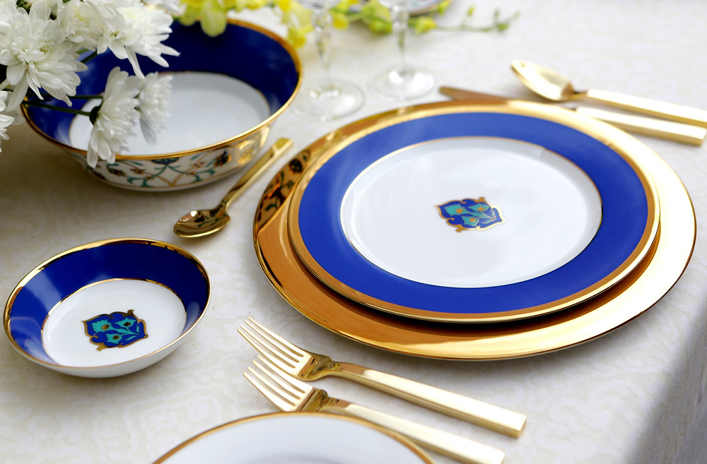 Shores of Persia is a soiree collection encrusted in 24-carat gold and hand-crafted in decadent shades of zaffre blue and turquoise.