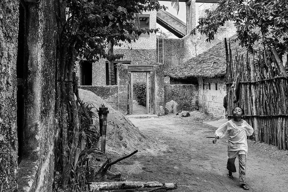 Girl skipping in Lamu street