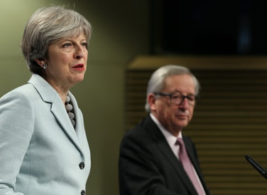 Tories welcome May's Brexit deal but EU warns of trade talk delays