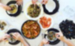 Family eating Paella and seafood. Top vi