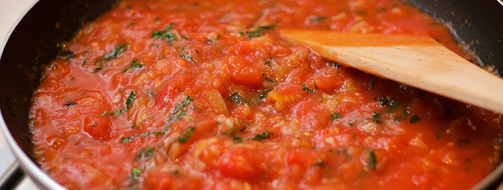 chopped tomato in a pan.jpg