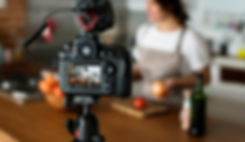Female vlogger recording cooking related
