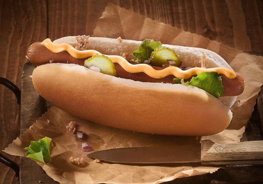 Hotdog bun with sausage with mustard and