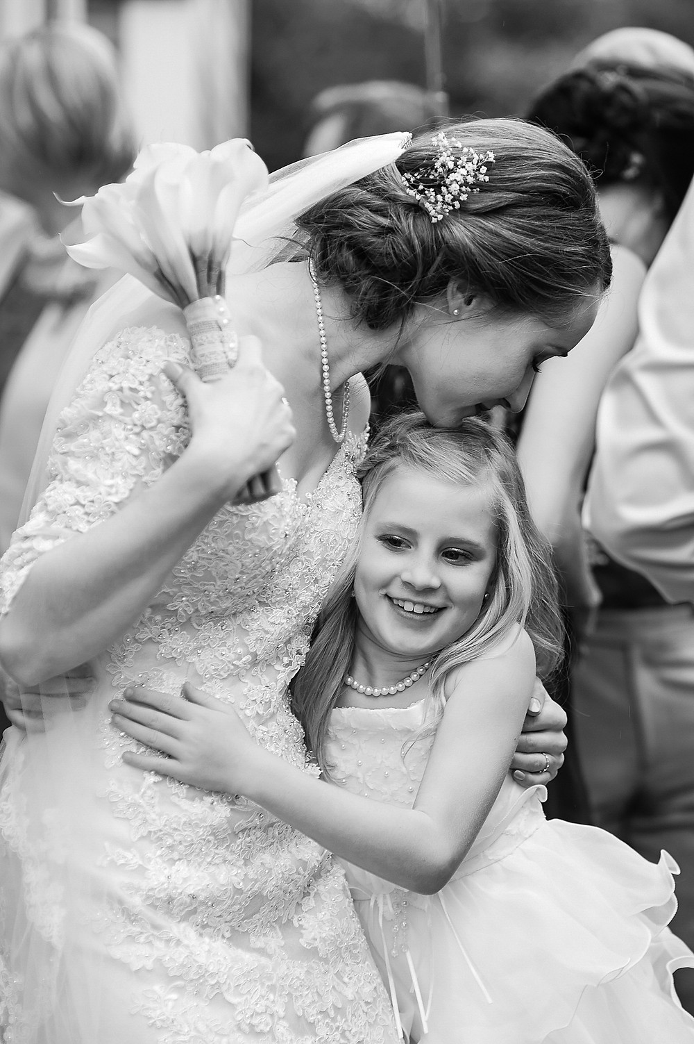 Bride with flower girl, documentary approach