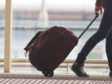 Going on holiday? How to carry your bags... and other holiday injury prevention tips